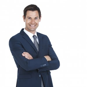 Cropped portrait of a handsome businessman standing with his arms folded isolated on white